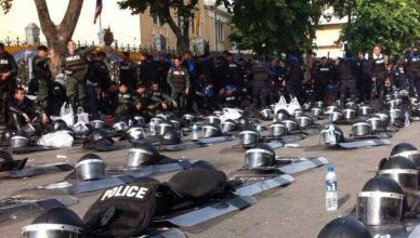 Police In Thailand Lay Down Vests and Barricades In Solidarity With Protestors
